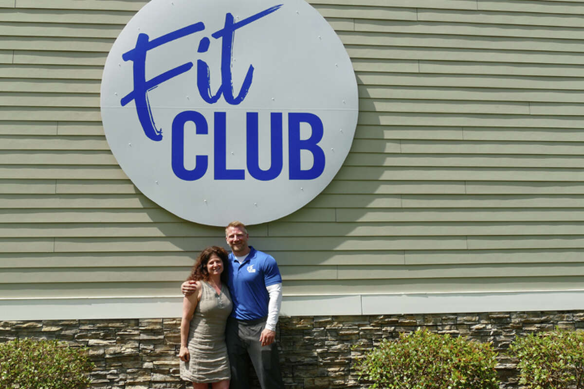 Fit Club co-owners Jenny Conciatore and Mike Subach stand beneath the new sign at 66 Grove Street. Conciatore is the business' general manager and Subach is the head trainer. They have been helping clients at 66 Grove Street for 14 and 15 years, respectively. Conciatore and Subach began renovating the building in March and opened as Fit Club on May 15. - Steve Coulter / Hearst Connecticut Media