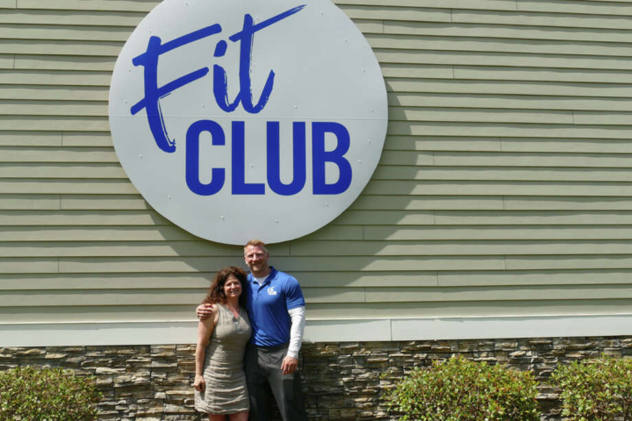 Fit Club co-owners Jenny Conciatore and Mike Subach stand beneath the new sign at 66 Grove Street. Conciatore is the business' general manager and Subach is the head trainer. They have been helping clients at 66 Grove Street for 14 and 15 years, respectively. Conciatore and Subach began renovating the building in March and opened as Fit Club on May 15. — Steve Coulter / Hearst Connecticut Media