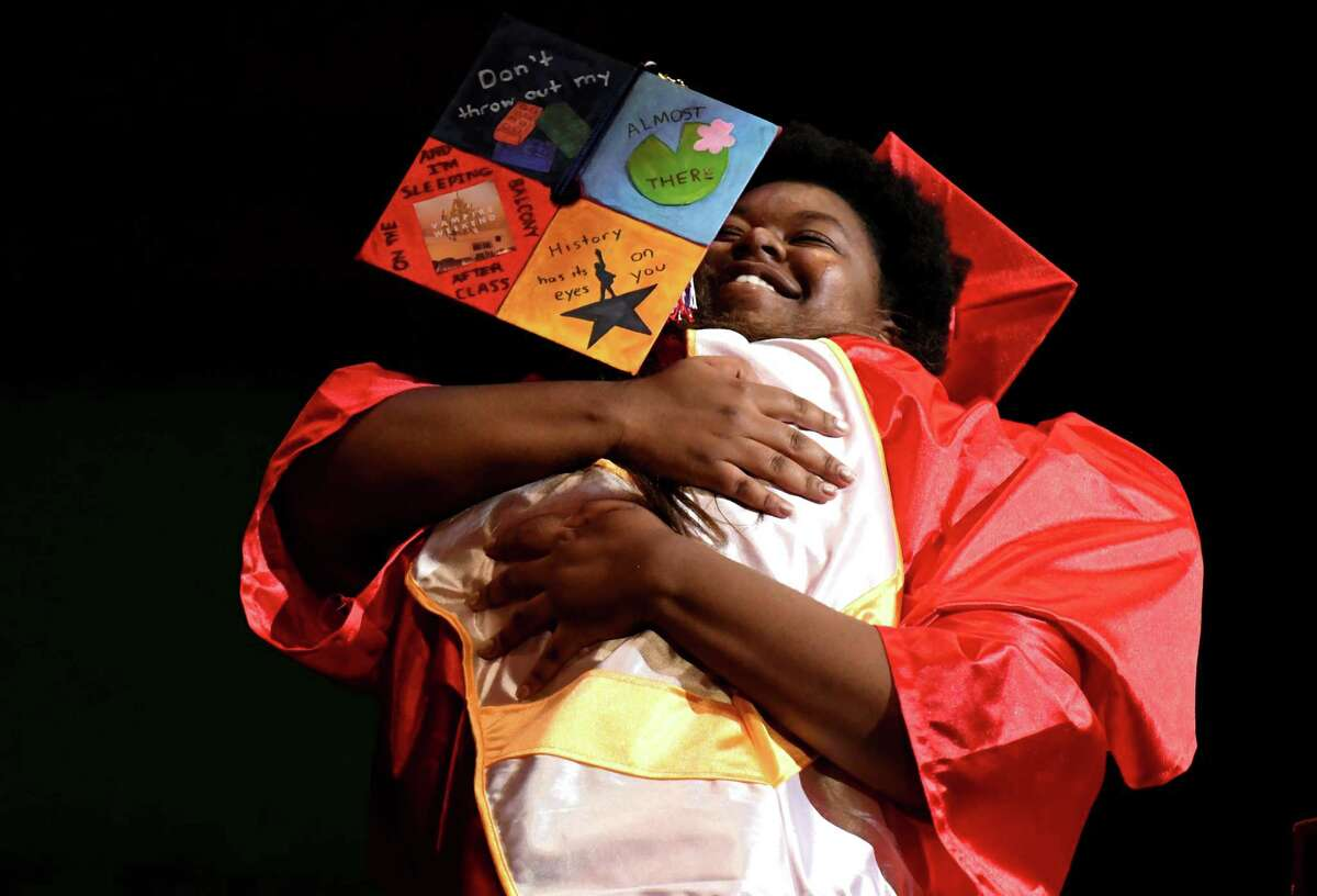 Schenectady High School valedictorian Anna Blanchfield, left, hugs class of 2019 president Natasha Wright, right, during the 27th commencement ceremony of Schenectady High School on Wednesday, June 26, 2019, at Proctors Theatre in Schenectady, N.Y. (Catherine Rafferty/Times Union)