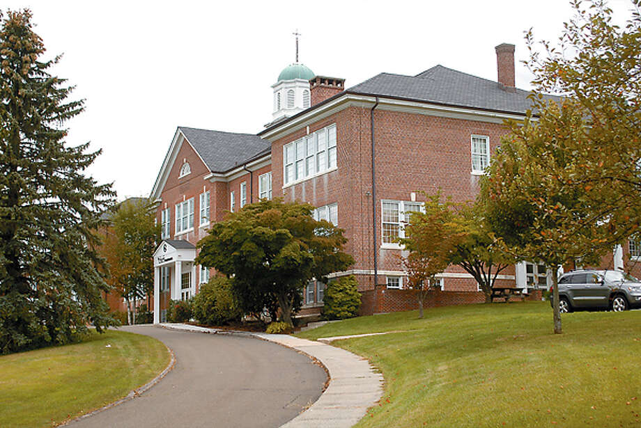 The brick Venus Municipal Building on East Ridge Road.