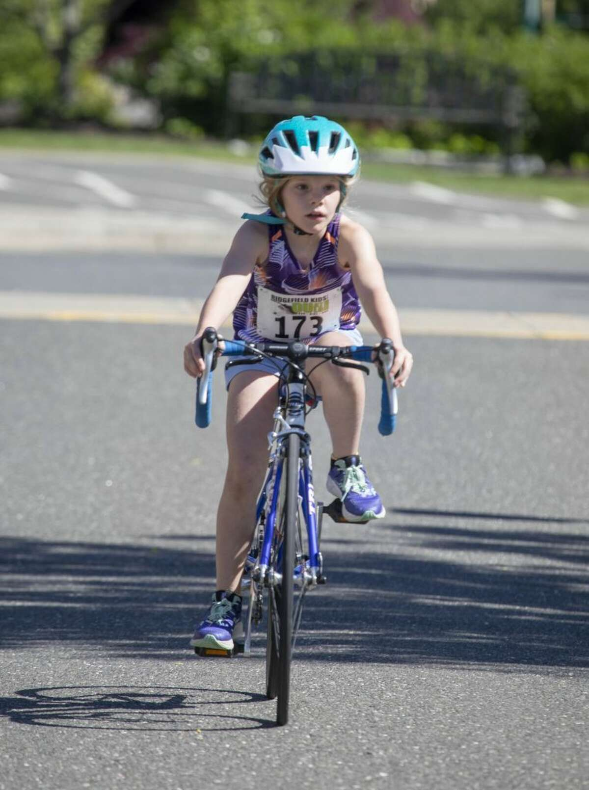 Abigail O'Neil rides her bike during the sixth annual Ridgefield Kids Duathlon at the Ridgefield Parks & Recreation Center on Sunday, June 9. More than 100 athletes between the ages of 4 and 14 raced a run/bike/run format on the closed parks and recreation campus. Blue skies, perfect temperatures and and big smiles were highlights of the morning. The Ridgefield Bicycle Sport Club organizes the race for the youth community every year in June.