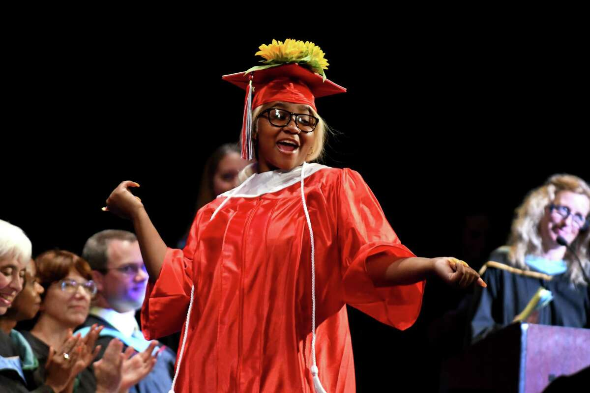 Chanae Washington crosses the stage to receive her diploma during the 27th commencement of Schenectady High School on Wednesday, June 26, 2019, at Proctors Theatre in Schenectady, N.Y. (Catherine Rafferty/Times Union)