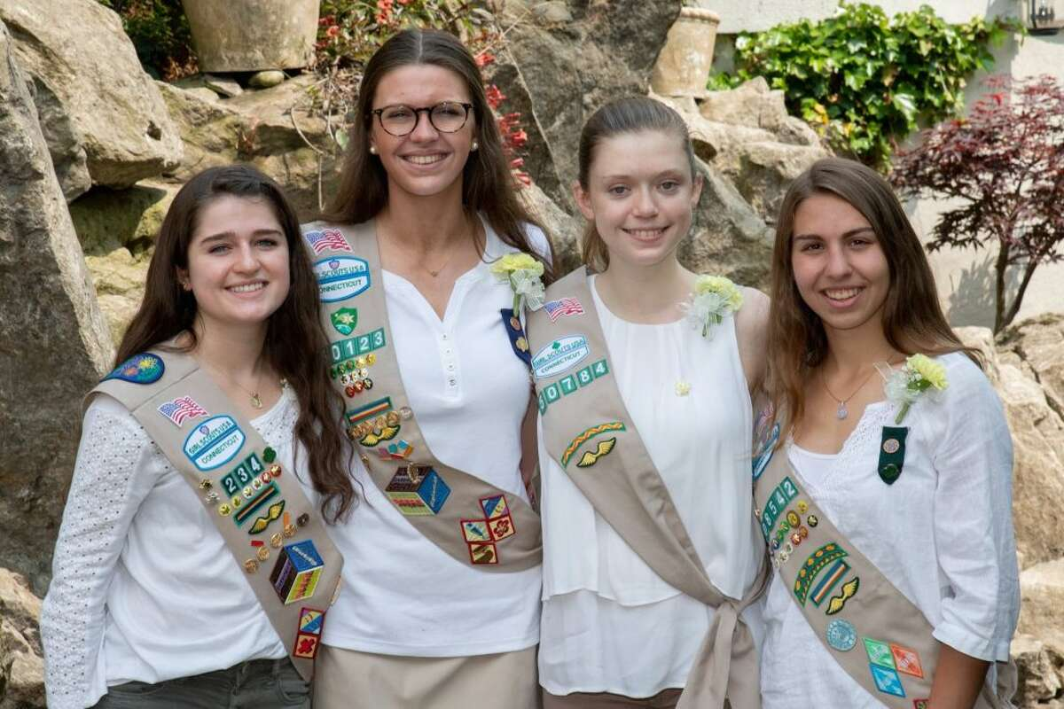 Four of eight Ridgefield Girl Scouts who won gold awards attended taken at the state ceremony. They are, from left:Charlotte Anglade,Bridget Kager,Abigail Morris,Elizabeth Jasminski.