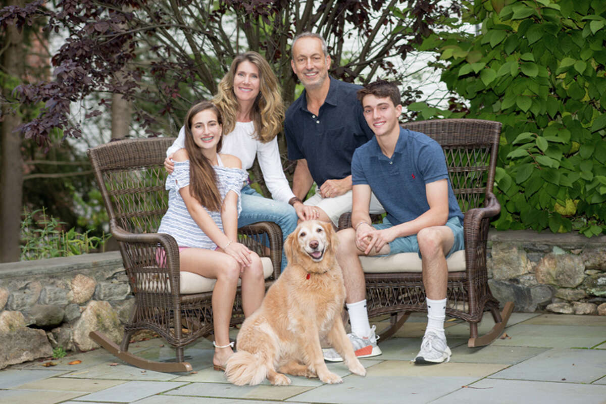 Josh Carone, far right, a former student at Wooster School, with his family. Carone was one of three students at Wooster School who earned an award from the state Department of Energy and Environmental Protection for trying to save the life of a woman killed on Candlewood Lake.