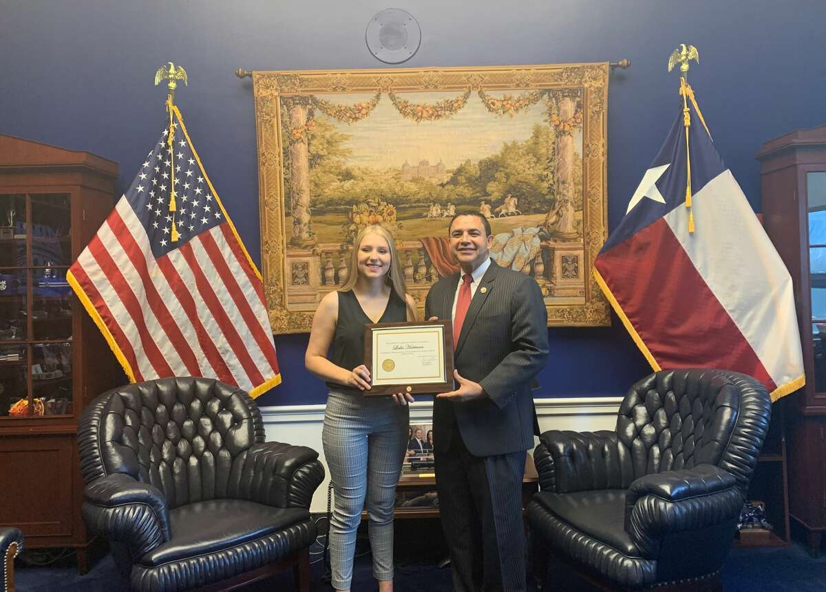 Pleasanton's Leslie Hartman was recognized in Washington Monday by Congressman Henry Cuellar for winning a congressional art competition.