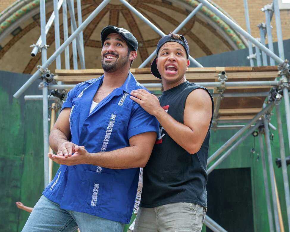 Adam James King, who is playing Usnavi De La Vega, and Luis Herrera, a member of the ensemble, in the Playhouse Stage Company?s production of ?In the Heights,? which will be at the Park Playhouse in Washington Park from June 28 through July 27 (Jim Franco/Special to the Times Union.)