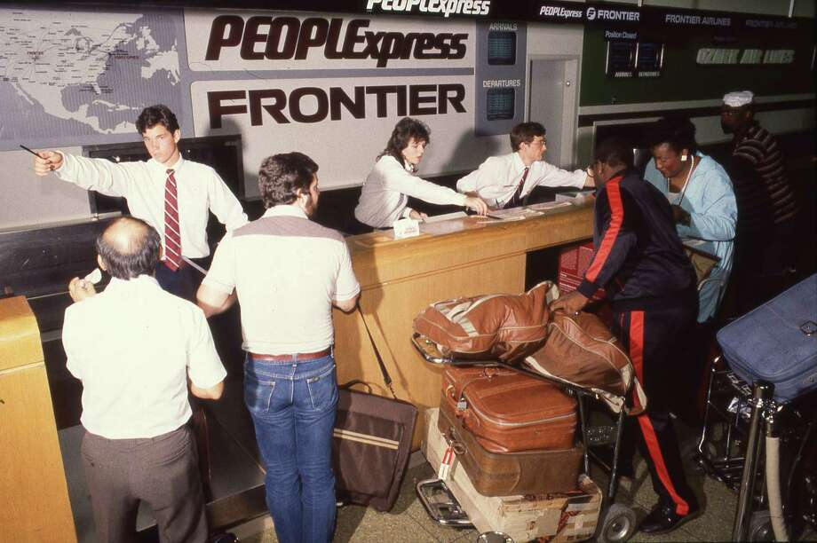 People Express Frontier ticket counter at Hobby Airport in Houston in 1986. Photo: John Makely / Houston Chronicle / Houston Chronicle