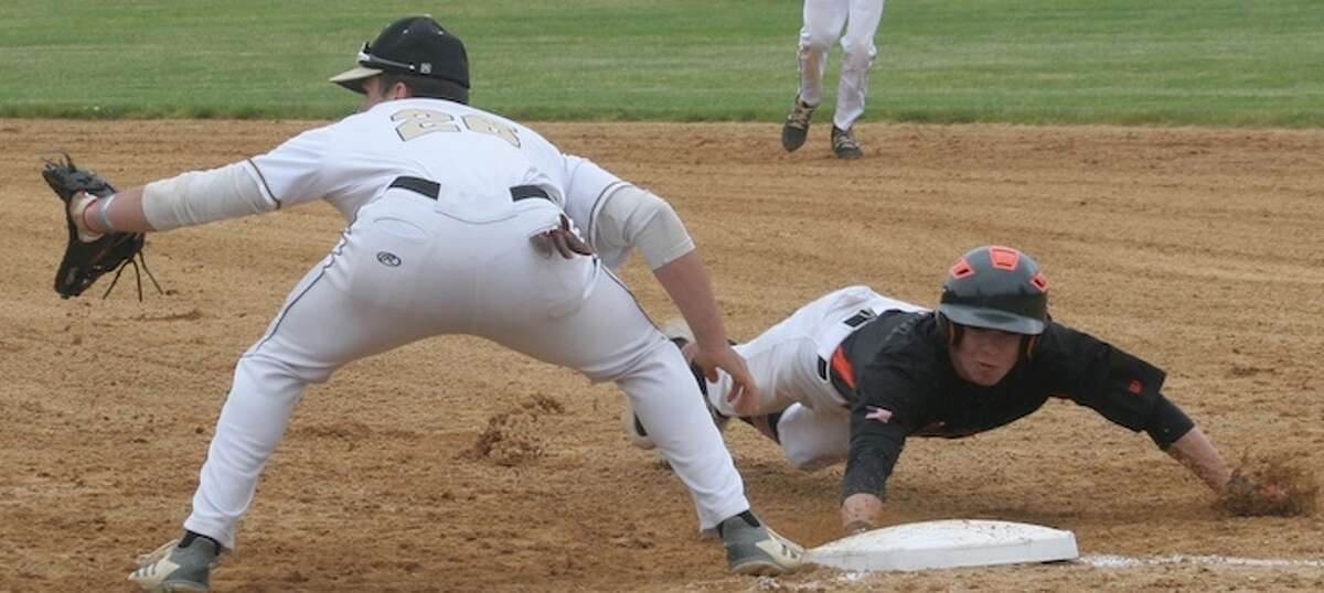 John Briody dives back to first base ahead of a pick-off attempt in Wednesday's Class LL game. - Bill Bloxsom photo