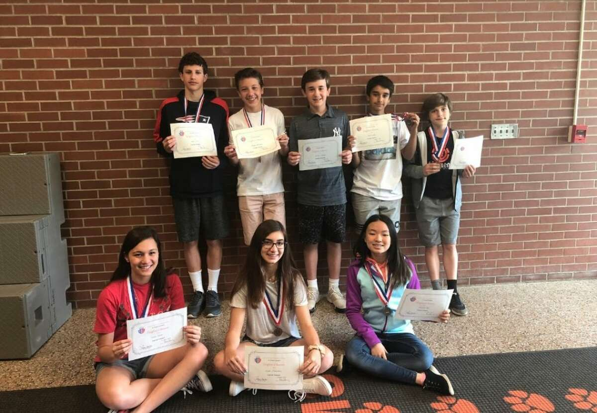 Pictured, top row from left to right: East Ridge Middle School students Ethan Walls, Anders Hoemann, Andrew Volgende, Ivan Gupta, and Pablo Rubio Lucia Bottom row, left to right: Emma Levine, Skylar Kleinman and Michele Kim. Not pictured: Ines Taleb, Stephanie Iwinski, Annabel Earle-Hecht, Keel McQuilkin, and Charlotte Ward.