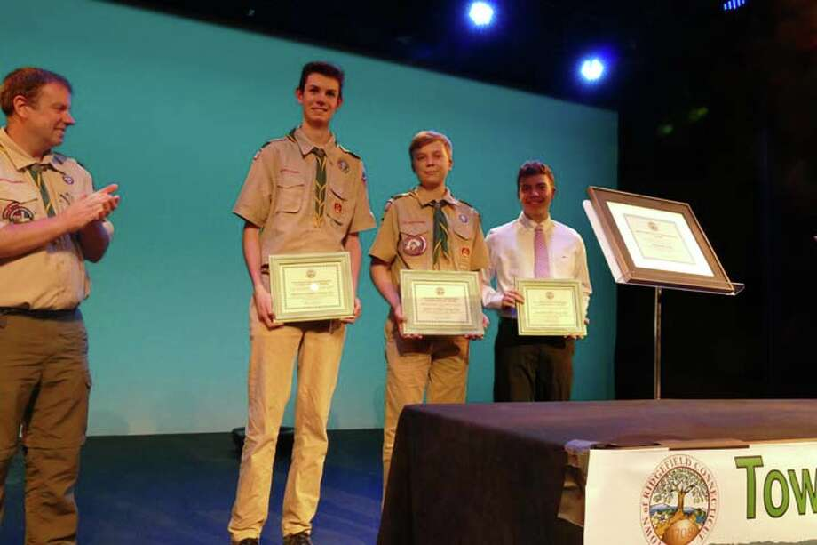 Ridgefield scouts from left to right: Nielsen Gordon, Lukas Dapkus, and Ian Ferguson were presented Environmental Awards for their work on improving Ridgefield's open spaces and trails.
