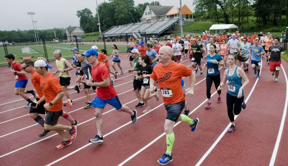 The annual Father's Day 5K race at the Ridgefield High School track in June 2017. The race celebrates its 20th anniversary this year.