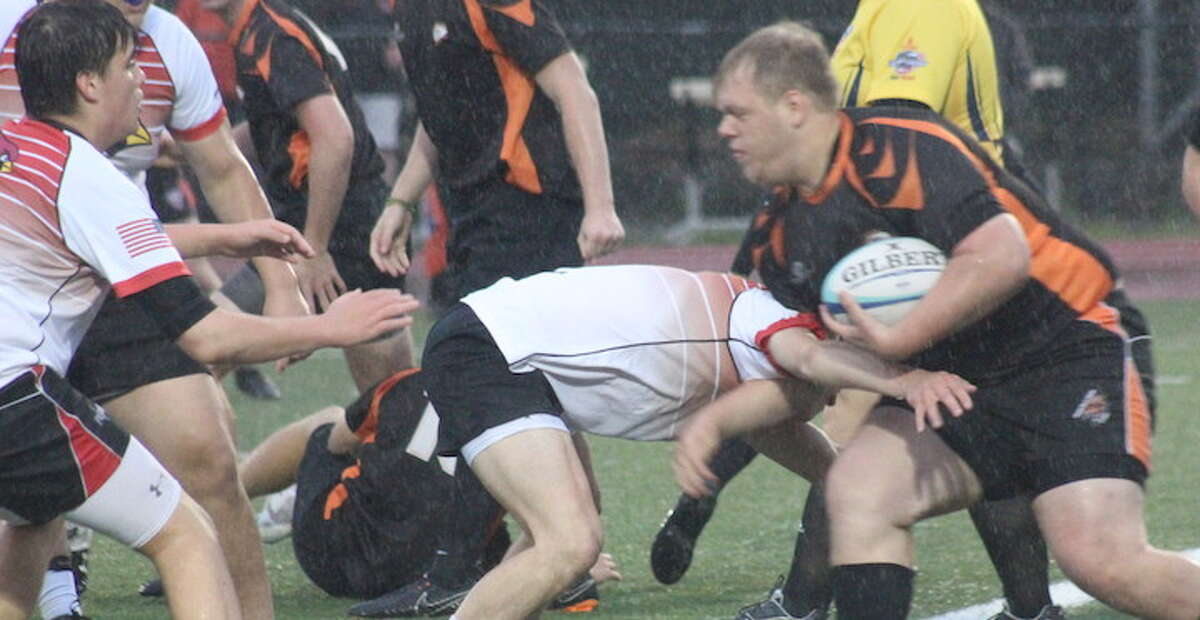 Peter Behnke powers into the try zone during Ridgefield's win over Greenwich in the Division 2 rugby state semifinals.