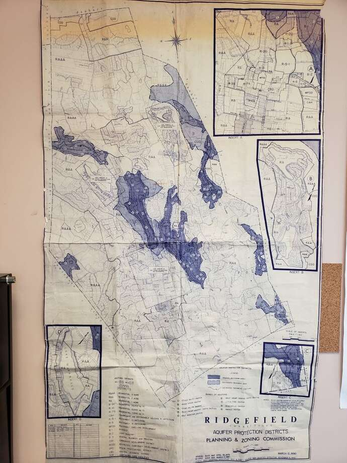 The DEEP map showing the Level A public watershed aquifer (the outlined sort of floral shape on the western border), as well as a map showing the locally defined aquifers (the dark areas).