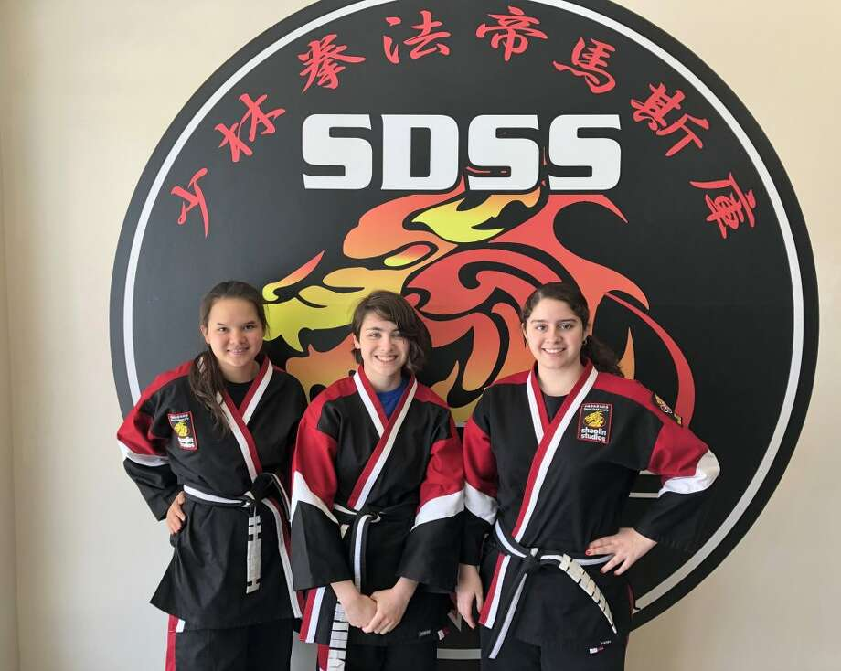 Ridgefield High School students Grace Goldberg, Nina Kropas and Antonella Risi earned their Zhongi Black Belt on April 27. They are part of Steve DeMasco's Shaolin Studios in Ridgefield and have been training for about nine years to reach this accomplishment.
