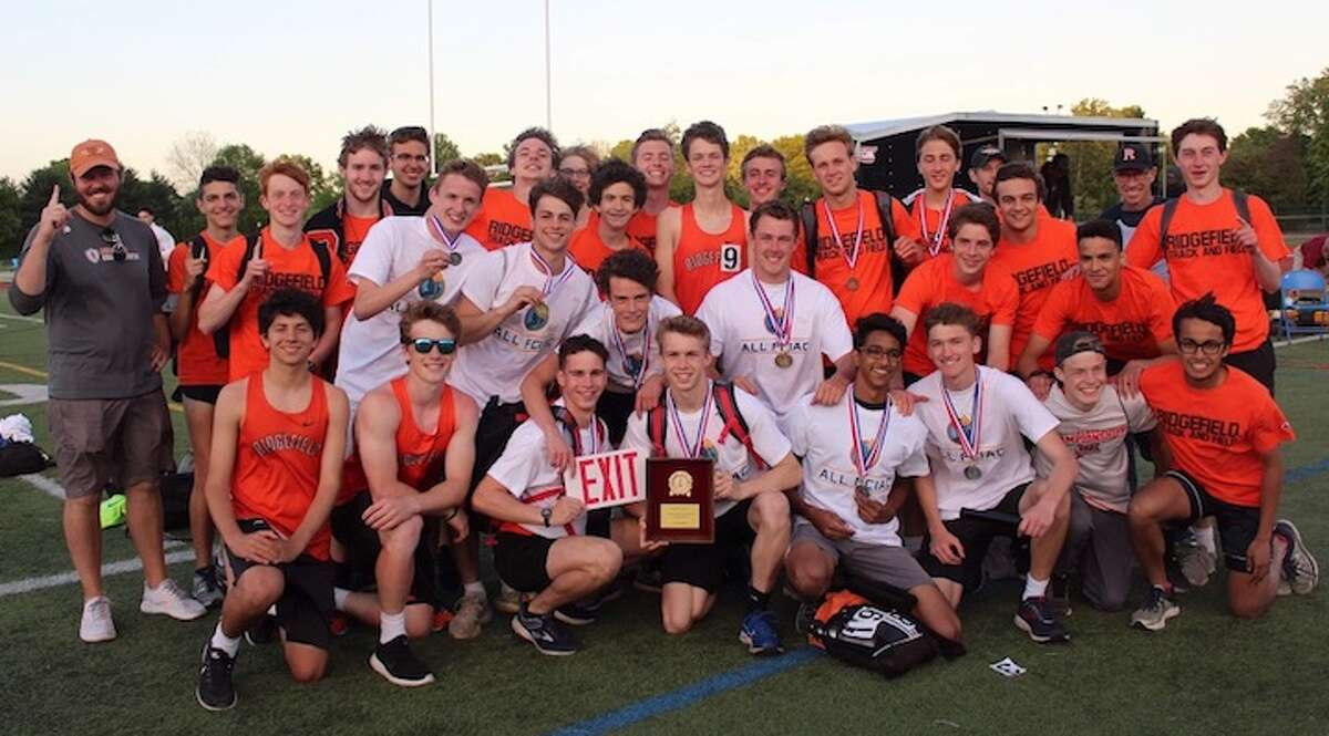 The Ridgefield High boys outdoor track and field team celebrates its FCIAC championship.