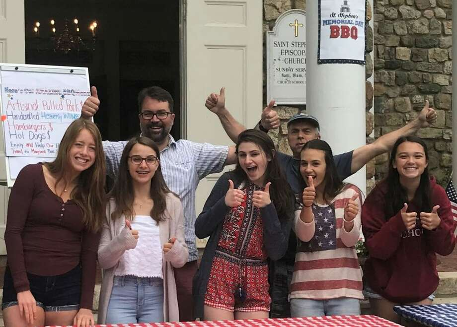 Participants in last year's H.O.P.E. trip helped Mark Blandford and his crew at St. Stephen's 2018 Memorial Day BBQ (left to right): Kirsten Pastore, Emily Brown, Mark Blandford, Molly Reiss, Jim Brown, Taylor Brown, and Kayleigh Bowler.