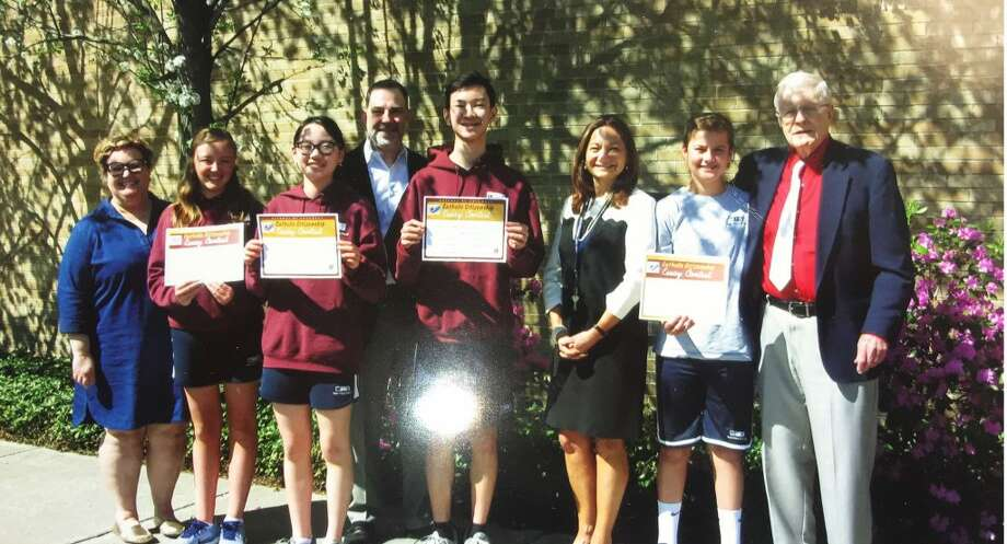 """The Knights of Columbus Council 245 has named St. Mary's eighth grade students Michaela Martin and Benjamin Gasparrini first place winners in the 2019 essay contest. Martin's essay also won third place in the Knights of Columbus state essay contest. Olivia Esposito and Matthew Uy won the """"Spirit Award"""" in the local contest. Pictured from left: Jennifer Kasinskas eighth grade teacher, Michaela Martin, Olivia Esposito, Grand Knight Philip Del Giudice, Matthew Uy, Principal Anna O'Rourke,Benjamin Gasparrini, Contest Chairman Dr. John Fisher."""