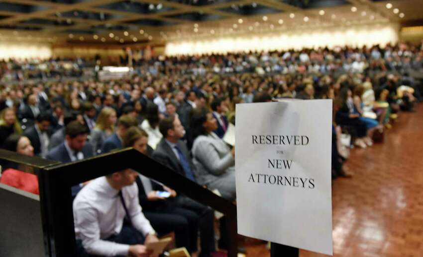 A sign indicates the seating section for the newly admitted members of the New York State Bar during a ceremony to admit new members into the New York State Bar on Wednesday, June 26, 2019 at the Empire State Plaza Convention Center in Albany, NY. (Phoebe Sheehan/Times Union)