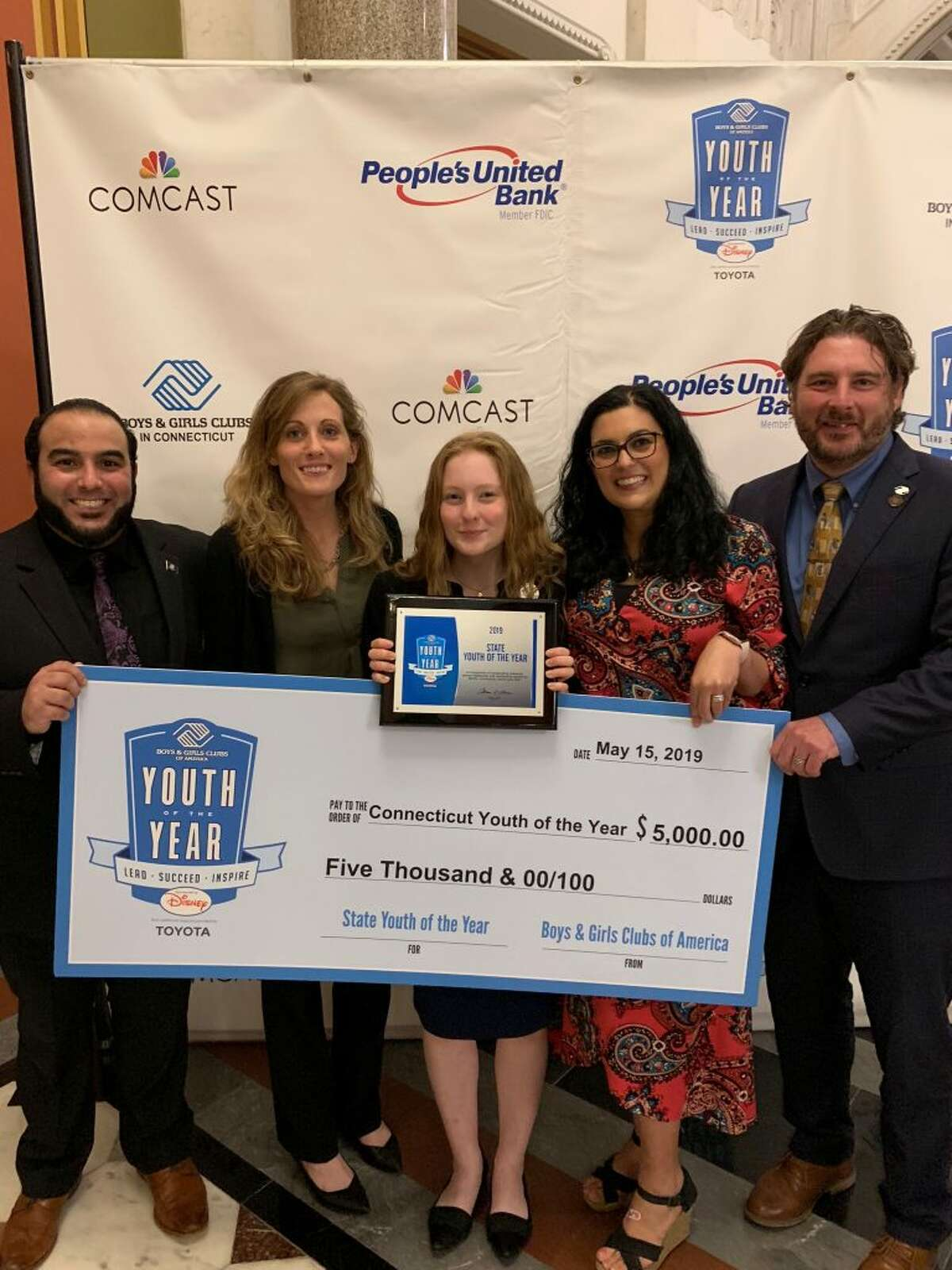 Allie Cauchon, middle, Boys & Girls Club of Ridgefield club member and the Connecticut Youth of the Year, is pictured here with Boys & Girls Club of Ridgefield staff members, from left to right, Jeff Goncalves, Program Director, Jess Podrazky, Senior Program Director, Allie Cauchon, Kristin Goncalves, Director of Operations, and Mike Flynn, Executive Director.