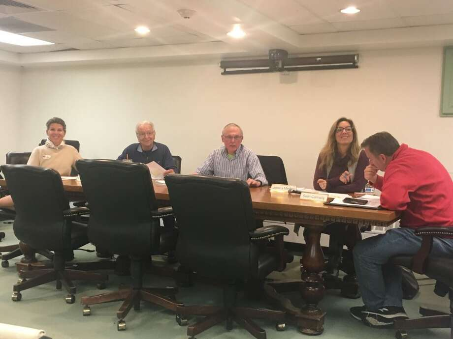 Ridgefield's Board of Finance deliberates in the lower level conference room in Town Hall Tuesday night. The Finance Board set the town's mill rate to 28.12 mills for the 2019-20 fiscal year after the town and school budgets passed at referendum Tuesday.