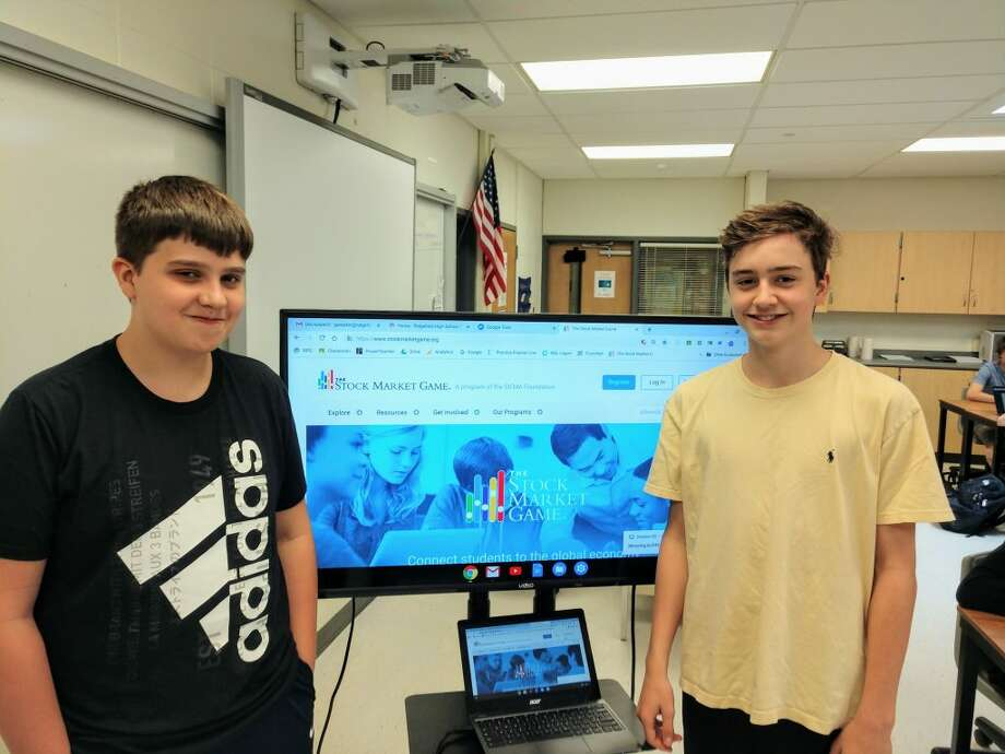 Ridgefield High School accounting students Sean Gabello and Fisher Mills finished first and third respectively in the state in the Stock Market Game investment competition.