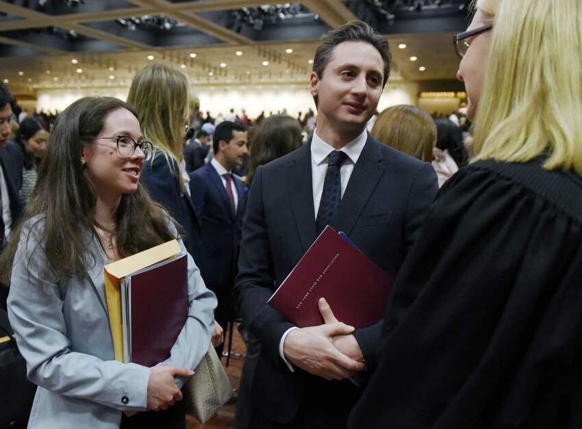 From left, newly admitted attorneys Natalia Filandrianou of Germany and Michael Constantine of Australia talk with Judge Christine M. Clark after a ceremony to admit new members into the New York State Bar on Wednesday, June 26, 2019 at the Empire State Plaza Convention Center in Albany, NY. (Phoebe Sheehan/Times Union)