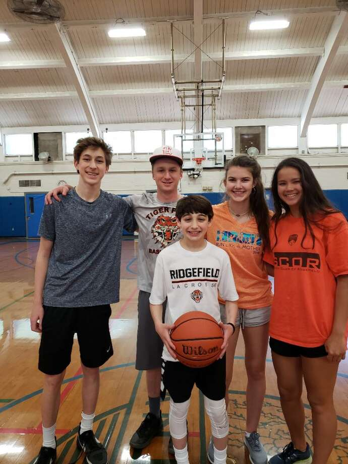Ridgefield Full Court Peace members (left to right) Shane Gagliardi, Jason Hartnett, Katie Flynn, and Rachel Tomasetti with participant Ethan Serby who requested donations in lieu of Bar Mitzvah presents. Not shown: Full Court Peace members Evan Collins, Finn Atkins, Sean Maue, Max Crowley, Kate Garson, and Jamie Narcisso.