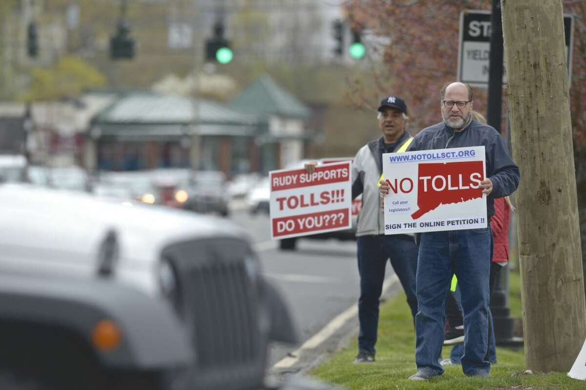 Rich Shapiro, of Southbury, right, and Joe Savino, of Ridgefield, take part in a No Tolls Ct protest at the corner of Copps Hill Road and Danbury Road on Saturday morning, April 27, 2019, in Ridgefield, Conn.