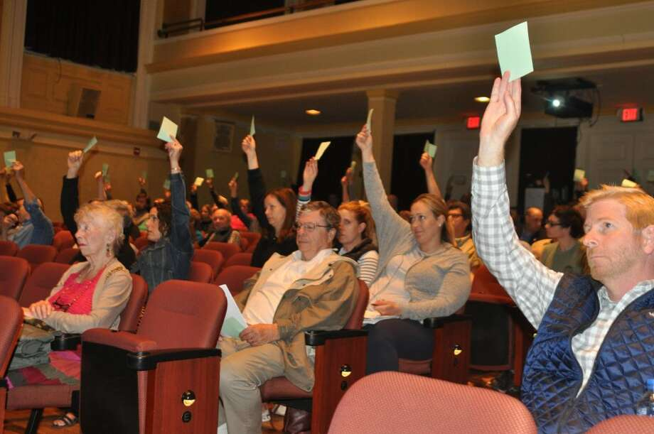 Ridgefield voters cast votes against budget critic Ed Tyrrell's motion to cut the school budget at the Ridgefield Playhouse Monday, May 6, 2019.