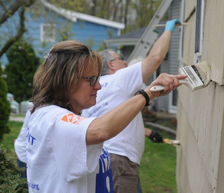 Lori Peterson painted as part of a volunteer crew fixing up a house as part of HomeFront Day on May 4, 2019.
