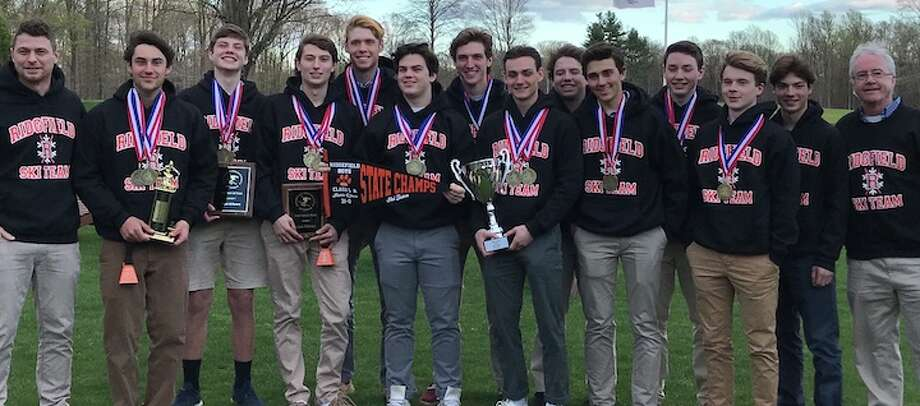 The Ridgefield High boys ski team and its coaches celebrate the team's state championship.