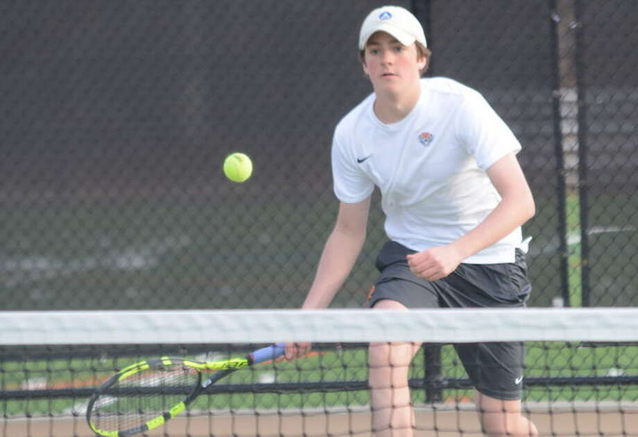 Carter Schroppe lines up a return shot during a recent Ridgefield High boys tennis match. — Andy Hutchison photo