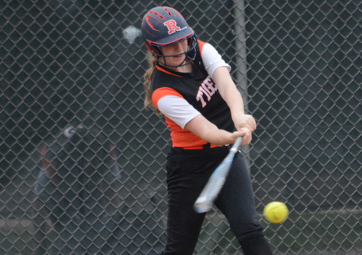 Julia Clavi swings at a pitch during Monday's game against St. Joseph. - Andy Hutchison photo