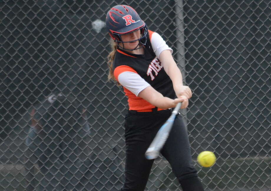 Julia Clavi swings at a pitch during Monday's game against St. Joseph. — Andy Hutchison photo
