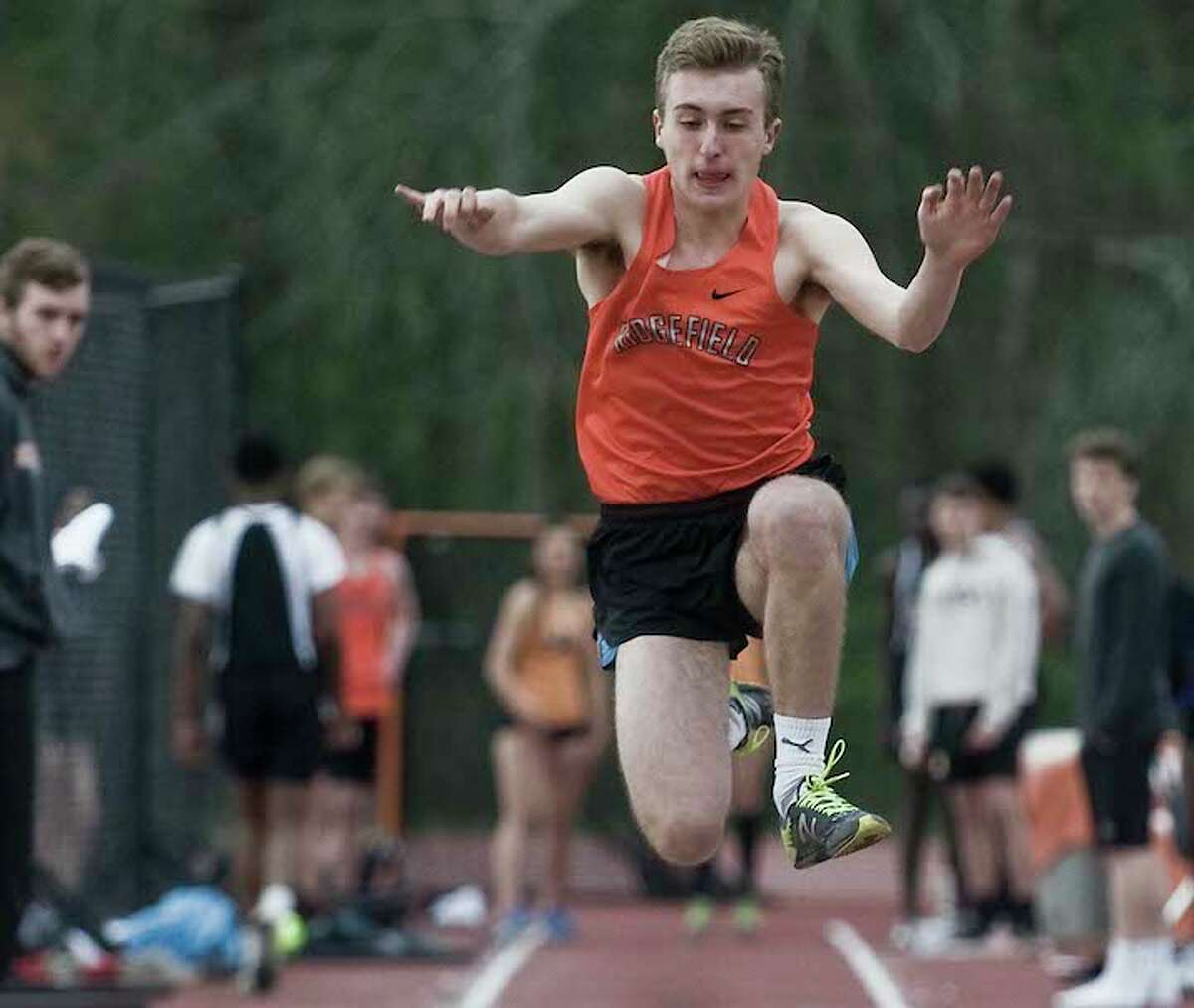 Ridgefield's Liam Smith won the triple jump in Monday's meet against Central and Westhill. - Scott Mullin photo