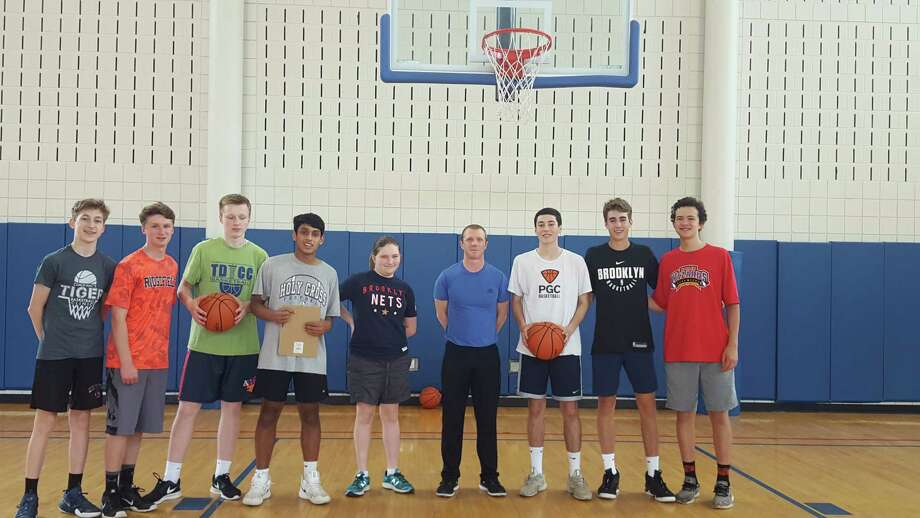 Local basketball referee Josh Davis, sixth from the left, made 37 of 50 free throw shots and helped raise $8,000 for the Trailblazers Academy basketball program last year. The initiative was sponsored by RHS's Full Court Peace Club and returns to Yanity gym this weekend. In 2018, more than $10,000 was raised by shooting free throws. Also pictured, from left: Shane Gagliardi, Jason Hartnett, Derek Szpakowski, Yohann Britto (club president), Maya Peck, James Rush, Emmett O'Malley, Quentin Vergara. For more information on Full Court Peace, visit fullcourtpeace.org.