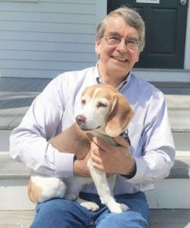 Bill Murrell with his beagle Brandi.