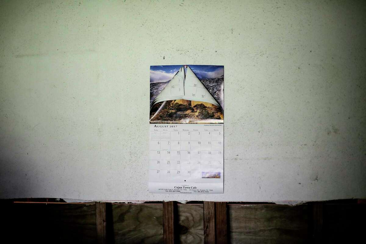 A calendar still on the month and year Harvey struck, is tacked to a moldy drywall wall in the home of Joe Fowler in the Kashmere Gardens neighborhood on Tuesday, June 18, 2019 in Houston.
