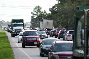 Traffic begins to backup for the evening drive down Wilson Road between Beltway 8 and Atascocita Road in Humble on Feb. 28, 2018. (Photo by Jerry Baker/Freelance)