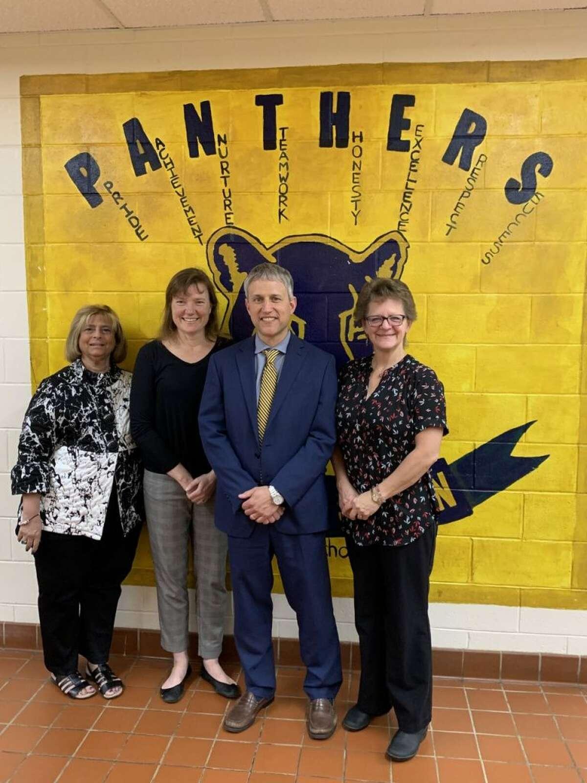 Madison Middle School teachers and KARE club advisors Nancy Yarmosh and Jeanne Malgioglio, MMS Principal Peter Sullivan and Binky Patrol co-founder JoAnn Zimmerman.