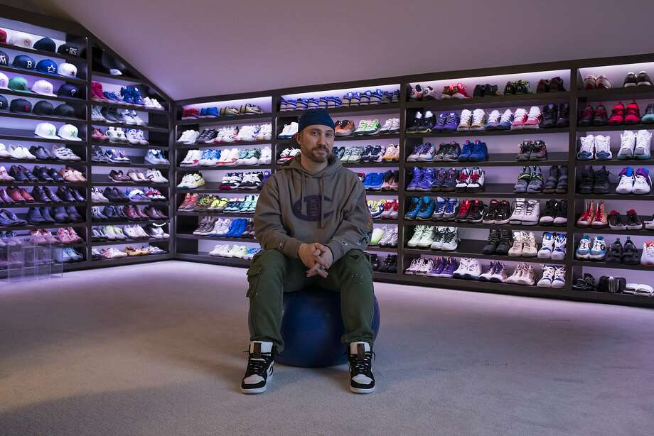 Josh Luber, co-founder of a website that eventually became StockX, displays his 350-pair sneaker collection. Photo: Brittany Greeson / New York Times