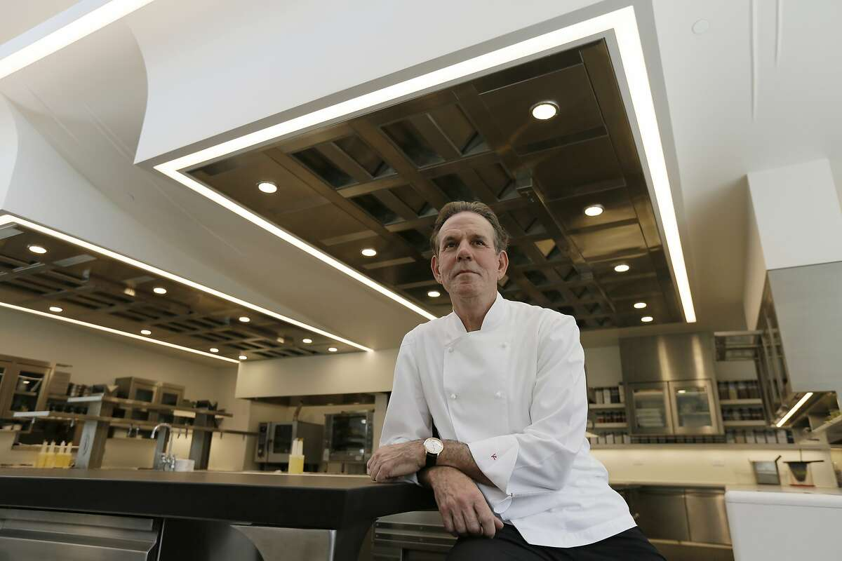 FILE - This March 9, 2017, file photo, shows celebrated chef Thomas Keller in the kitchen of his French Laundry restaurant in Yountville, Calif. A former employee of celebrated chef Thomas Keller is suing him and his three-star Michelin restaurants, Per Se in New York and the French Laundry in California, for discrimination, saying she was denied a job transfer and ultimately let go because she was pregnant. Vanessa Scott-Allen is seeking $5 million in damages for allegations that include sex discrimination and violation of pregnancy disability leave and says she hopes her trial, which starts Monday, June 3, 2019, will draw attention to a