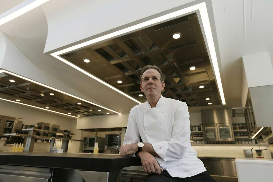 """FILE - This March 9, 2017, file photo, shows celebrated chef Thomas Keller in the kitchen of his French Laundry restaurant in Yountville, Calif. A former employee of celebrated chef Thomas Keller is suing him and his three-star Michelin restaurants, Per Se in New York and the French Laundry in California, for discrimination, saying she was denied a job transfer and ultimately let go because she was pregnant. Vanessa Scott-Allen is seeking $5 million in damages for allegations that include sex discrimination and violation of pregnancy disability leave and says she hopes her trial, which starts Monday, June 3, 2019, will draw attention to a """"culture of misogyny in fine dining,"""" said her attorney, Carla Minnard. (AP Photo/Eric Risberg, File) Photo: Eric Risberg, Associated Press"""