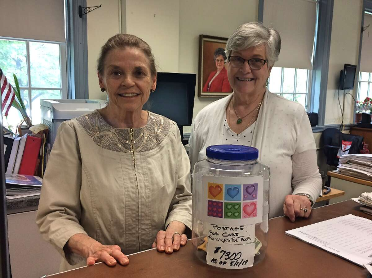 Town Clerk Suzanne Burr-Monaco and Assistant Clerk Gloria Murphy may retire the Care Packages for Troops donation jar that has been a fixture in the office since 2010.