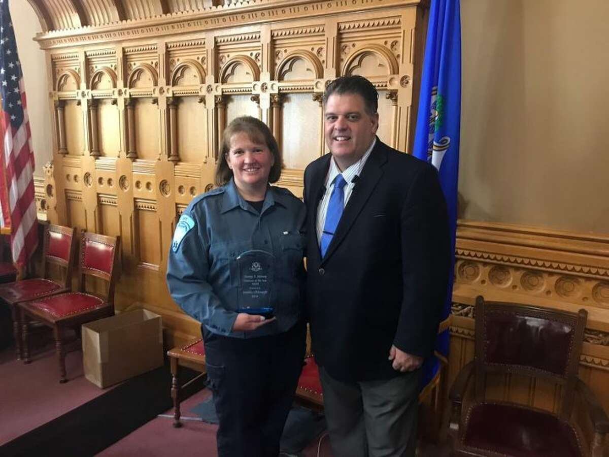 State Rep David Rutigliano recently honored Trumbull EMT Jen DiJoseph at a ceremony at the State Capitol.