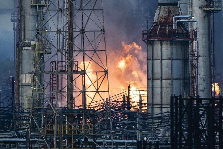 Flames and smoke emerge from the Philadelphia Energy Solutions Refining Complex in Philadelphia, Friday, June 21, 2019. (AP Photo/Matt Rourke) Photo: Matt Rourke, Associated Press