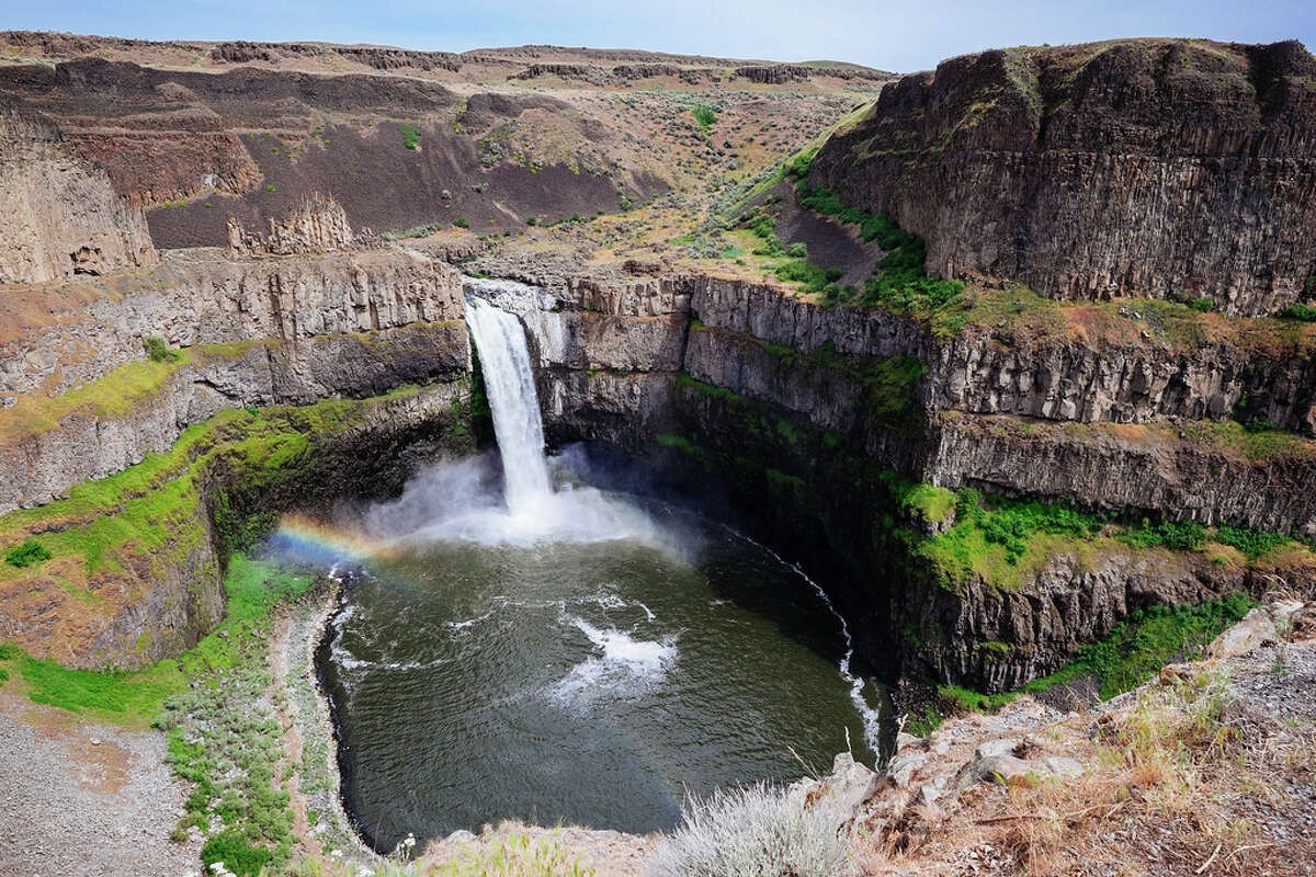 Palouse Falls is the official waterfall of Washington State and a result of the glacial floods during the ice age, given it's a mammoth 198-foot drop. Only a mile-long hike around the top of the falls, this one requires a Discover Pass. There is a small path winding down to the plunge pool, but taking the trail down to the falls is discouraged as the trek is incredibly slippery, rocky, and dangerous. People have been injured or died as a result of going outside of designated areas, and trekking down threatens and erodes sacred sites of Tribal people, and fragile ecosystems, according to the Washington State Parks and Recreation Commission.