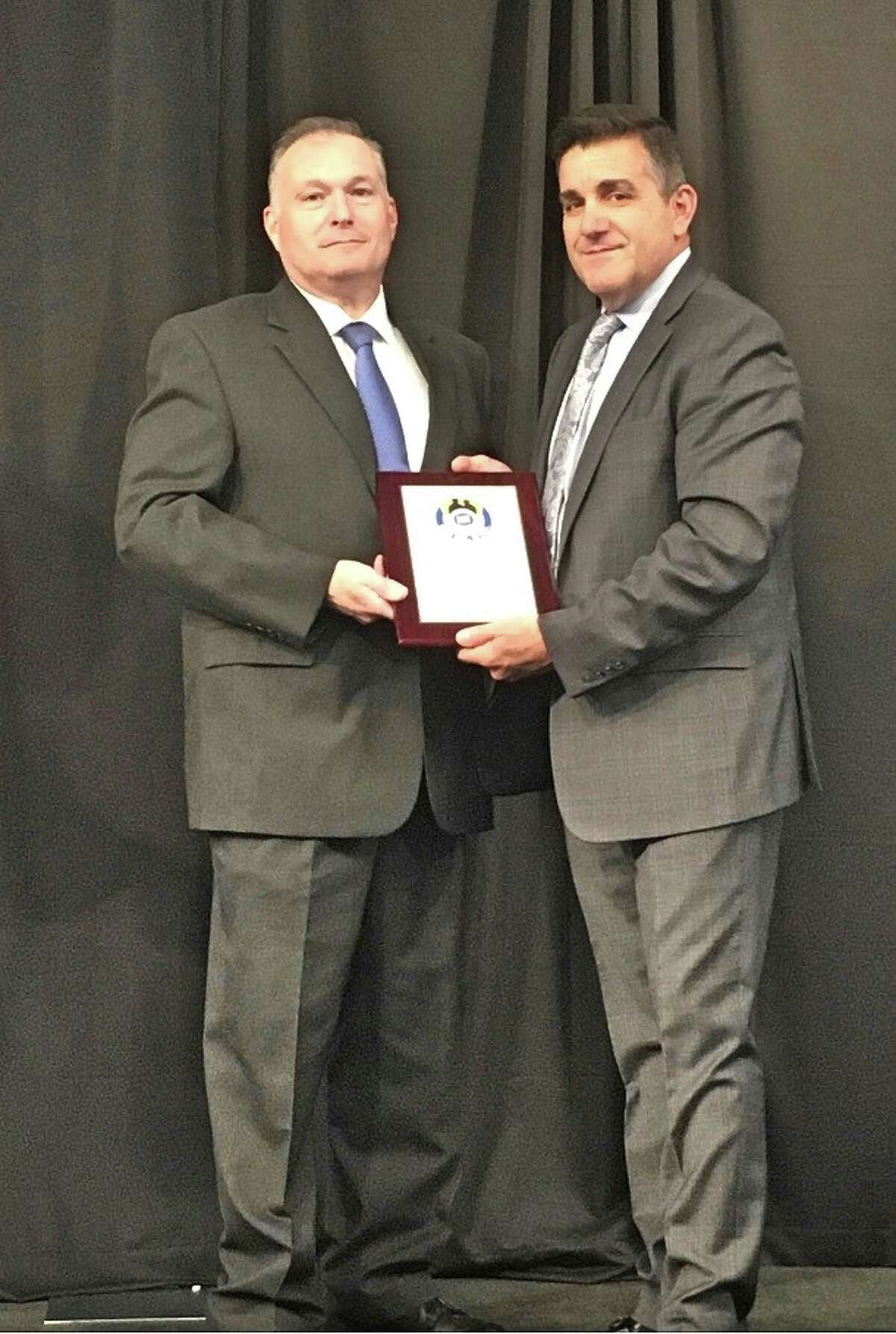 Chief Michael Lombardo, left, accepts a state Chiefs of Police Association award for officer wellness programs.