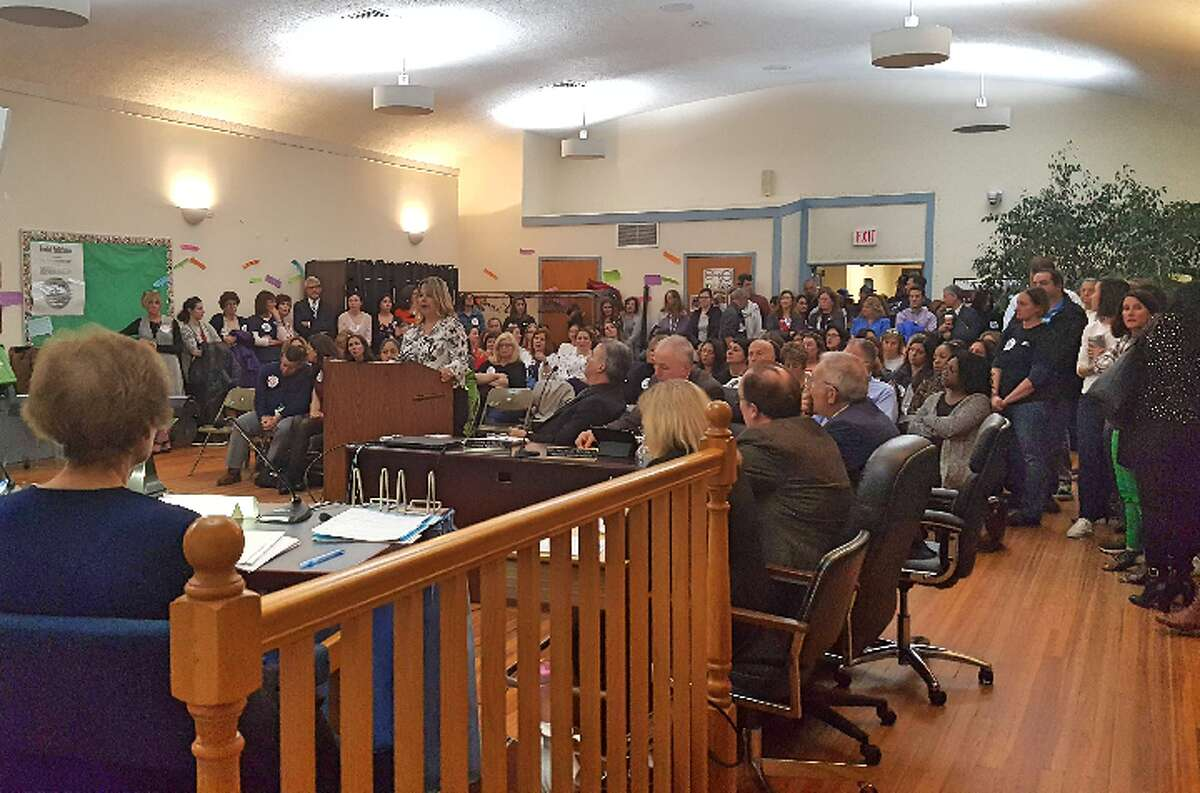 Parents line up to speak in support of Principal Laura Cretella during Tuesday's school board meeting.