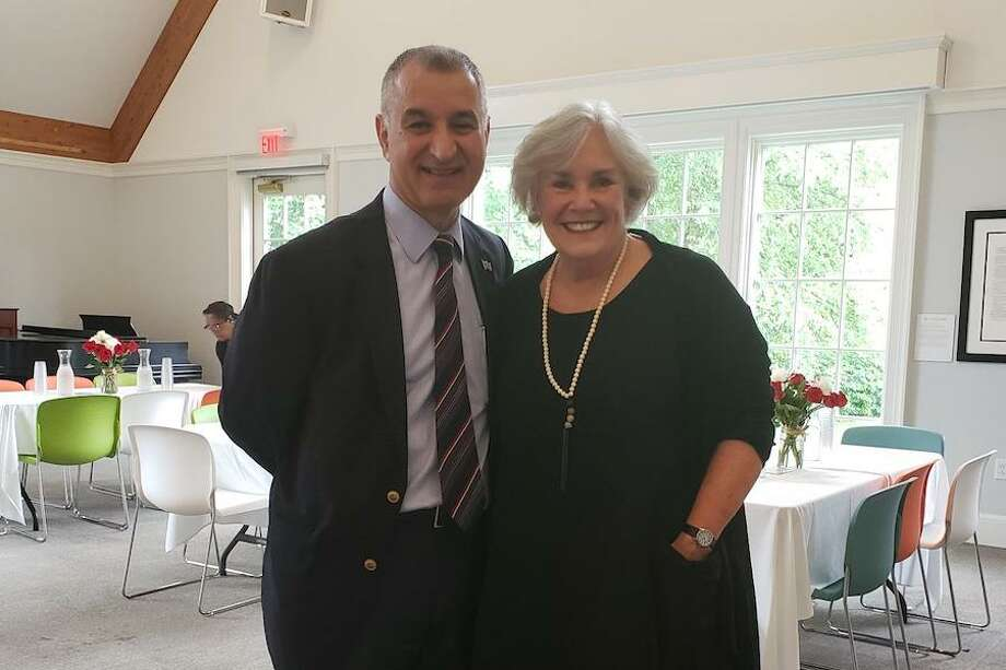 Ceci Maher is joined by state Senator Carlo Leone (D-Stamford) at her retirement party. — Sandra Diamond Fox/Hearst Connecticut Media / Connecticut Post